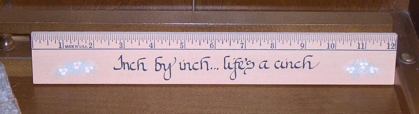 30.48 cm = 12 inches,