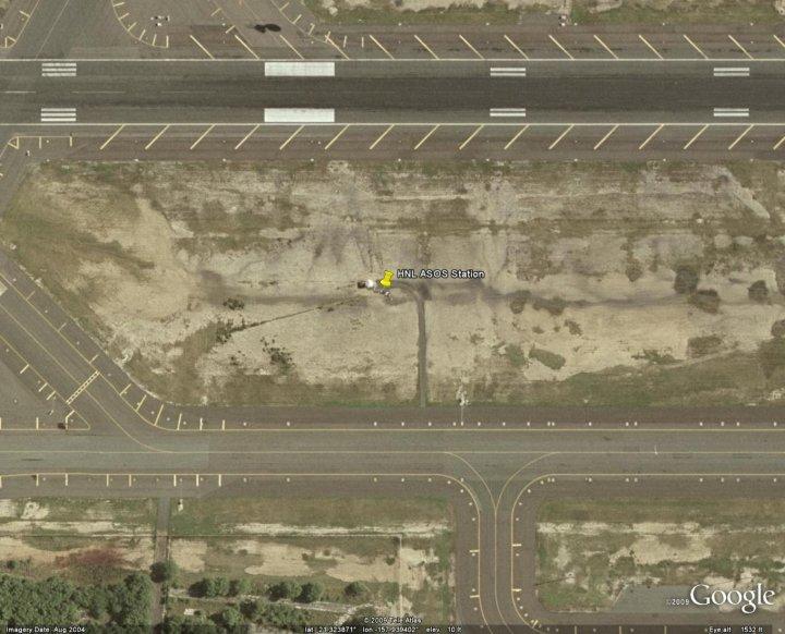 Honolulu's ASOS temperature sensor - surrounded by asphalt - click for larger image
