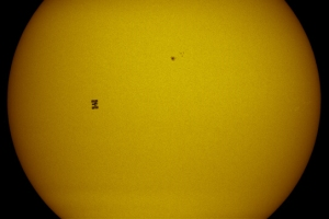 ISS and Atlantis Transit the Sun's Face