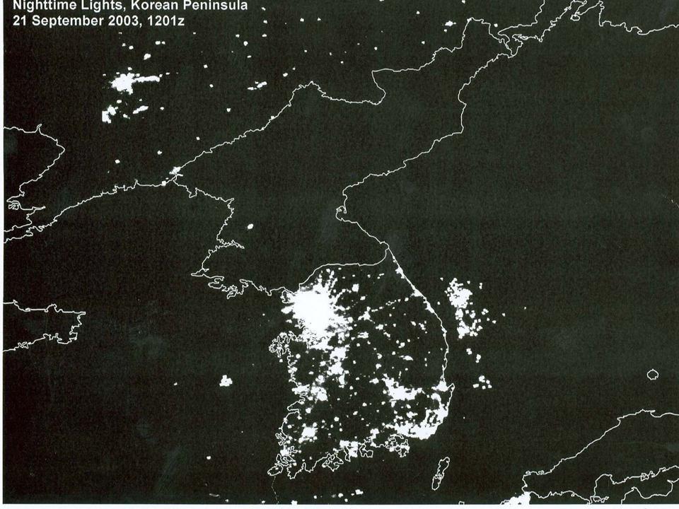 satellite image of the korean penninsula at night, showing city lighting