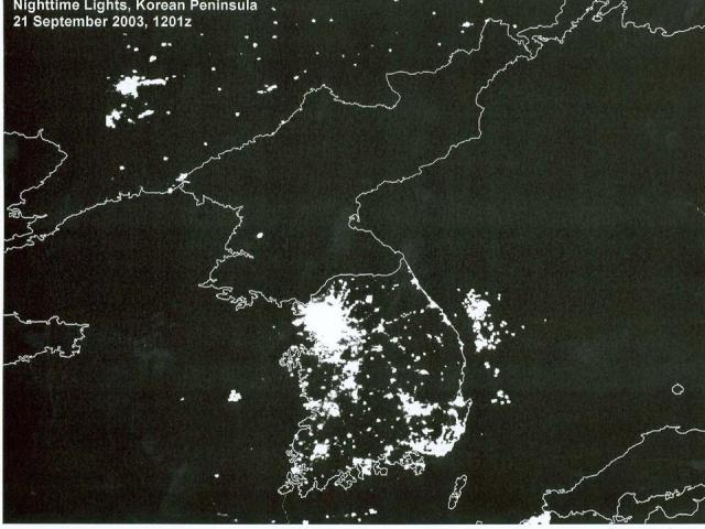satellite image of the korean penninsula at night, showing city lighting