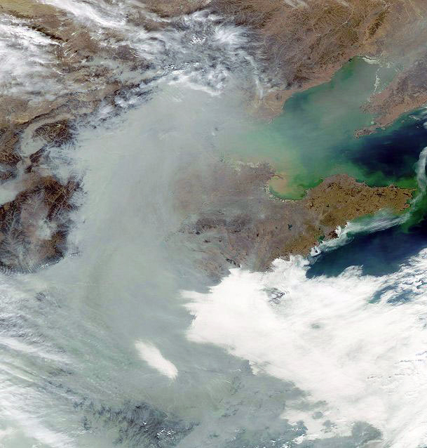 A satellite image shows pollution over eastern China in February 2004. The pollution, consisting mostly of soot and sulfate particles, was created from coal and wood burning and persisted throughout the winter.