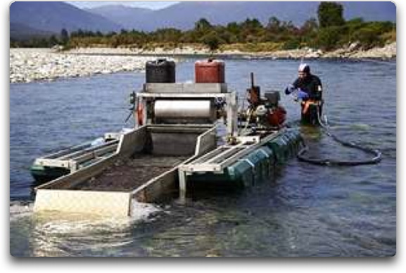 gold suction dredge on surface