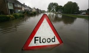 A-flood-sign-warns-of-flo-001-300x180[1]