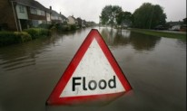 A-flood-sign-warns-of-flo-001-300x180[1]