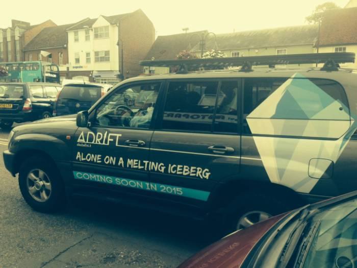adrift_on_an_iceberg_guy_drives_SUV