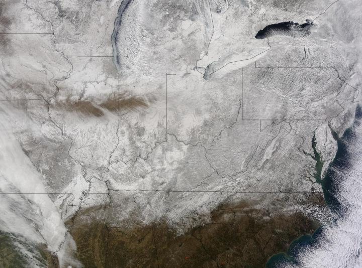NASA's Terra satellite captured this picture of snow across the eastern United States on Feb. 19 at 16:20 UTC (11:20 a.m. EST). Credit: NASA Goddard MODIS Rapid Response Team - Click to enlarge
