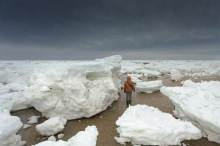 Giant blocks of ice wash ashore at Cape Cod