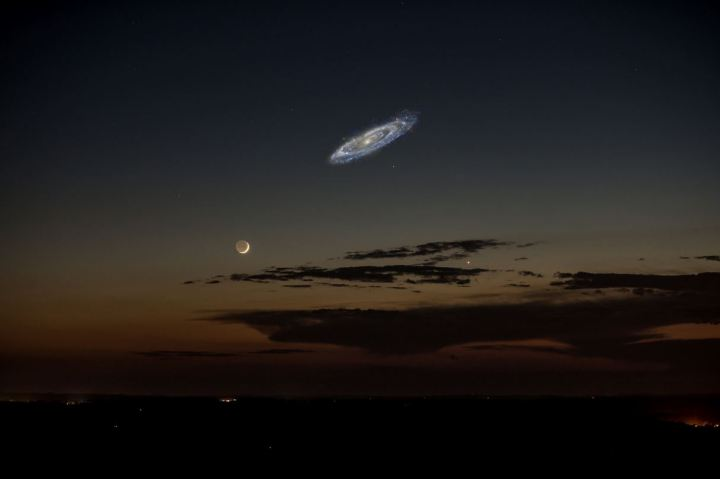 The Andromeda galaxy M31 is larger than the moon, but isn't noticeable due to its low brightness. Composite photo by Tom Buckley-Houston; background taken by Stephen Rahn on June 10, 2013.