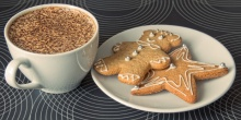 Coffee with chocolate shavings and ginger snap. Uploaded by Magnus Manske Author Andy One. Source Wikimedia (attribution license)
