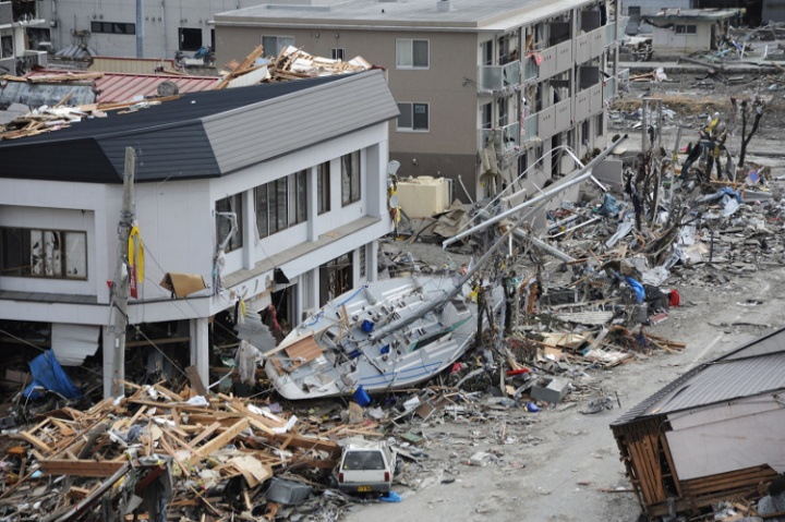 OFUNATO, Japan (March 15, 2011) A fishing boat is among debris in Ofunato, Japan, following a 9.0 magnitude earthquake and subsequent tsunami. (U.S. Navy photo by Mass Communication Specialist 1st Class Matthew M. Bradley/Released)
