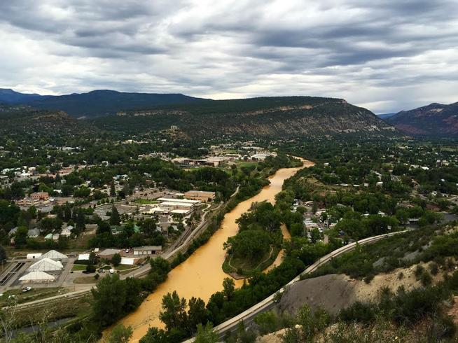 Polluted water flows down the Animas River Friday morning, August 7, 2015. (Brent Lewis, The Denver Post)