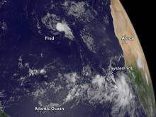 This visible image of the Eastern Atlantic Ocean on Sept. 4 at 7:45 a.m. EDT shows Tropical Depression Fred winding down and another low pressure area that just came off the West African coast. Credits: NASA/NOAA GOES Project