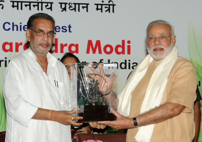The Union Minister for Agriculture Radha Mohan Singh (left) presenting the memento to Prime Minister Narendra Modi at the 86th Foundation Day of ICAR and ICAR award presentation ceremony, in New Delhi. https://commons.wikimedia.org/wiki/File:PM_Modi_at_the_86th_ICAR_Foundation_Day.jpg