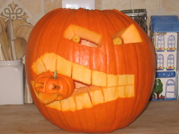 A two-pumpkin jack-o'-lantern design that won First Prize in an office party contest. Carved by Gregory Kohs.