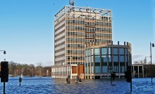 Carlisle Civic Centre amid floodwater, author Rose and Trev Clough, source Wikimedia