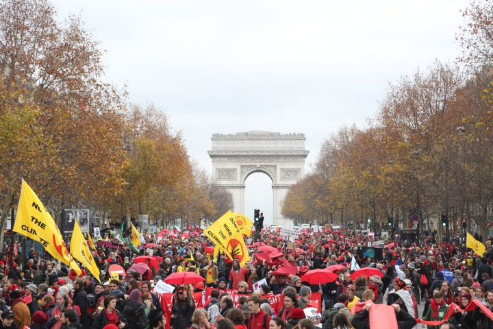 The COP21 clown show near the Arc de Triomphe in Paris. Image via 350.org Flickr account