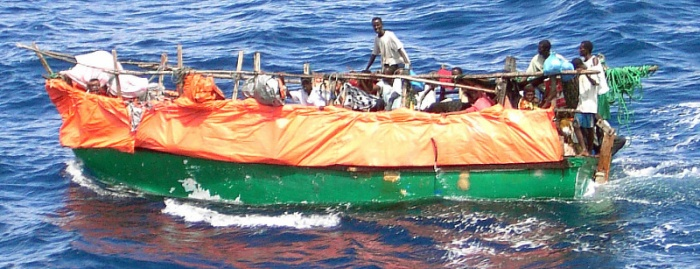 Crew members assigned to the US Navy (USN) Cyclone Class Coastal Defense Ship USS FIREBOLT (PC 10) rescue refugees from Somalia after their boat, a fishing Dowel, capsized somewhere out in the Indian Ocean (IOC). The FIREBOLT is currently providing Maritime Security Operations (MSO) in support of Operation ENDURING FREEDOM, Public Domain Image, source Wikimedia.