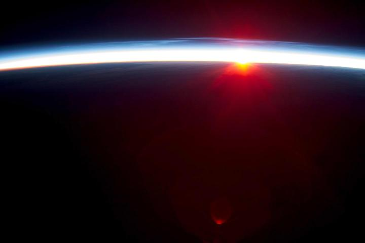 The Earth's thin atmosphere as viewed from space. A new study from NASA and Duke finds natural cycles alone aren't sufficient to explain warming trends observed over the last century. CREDIT Credit: NASA