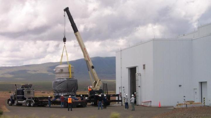 Workers prepare to install equipment at the LIGO facility in Hanford, Washington, in 2011.