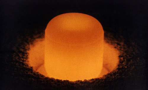 Pellet of Plutonium 238 glowing red hot, under its own heat. Public domain image, source Wikimedia.