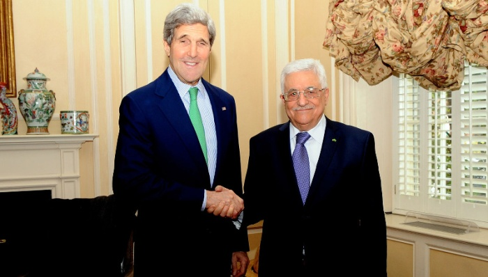 U.S. Secretary of State John Kerry shakes hands with Palestinian Authority President Mahmoud Abbas before a meeting in Washington, D.C., on March 16, 2014. (State Department photo/ Public Domain)