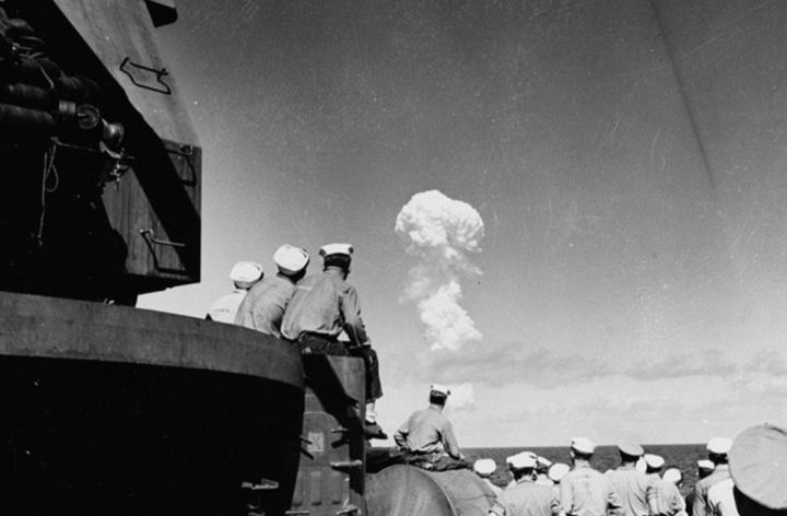 The newly declassified images show the World War II aircraft carrier which was one of nearly a hundred ships used as targets in the first tests of the atomic bomb at Bikini Atoll in 1946. Here, Sailors watch the 'Able Test' burst miles out to sea from the deck of the support ship USS Fall River on 1 July 1946. Image: Naval Archives