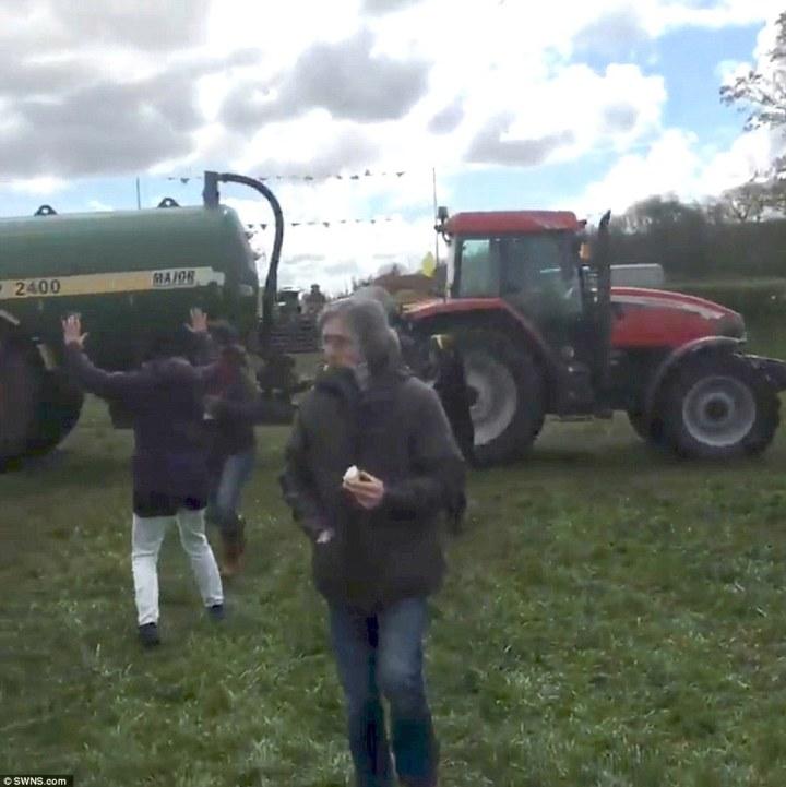 manure-splashed_A_Greenpeace_protester