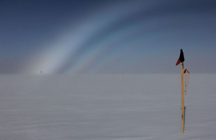 Kevin Hammonds (of the National Science Foundation-funded ICECAPS project; PI Von Walden) took this picture of a fogbow over Summit Station's Temporary Atmospheric Watch Observatory. Fogbows are the cold region analogue of rainbows, where incoming light interacts with very small water droplets or mist.