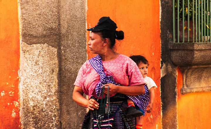 Woman with child in the street of Antigua, Guatemala.