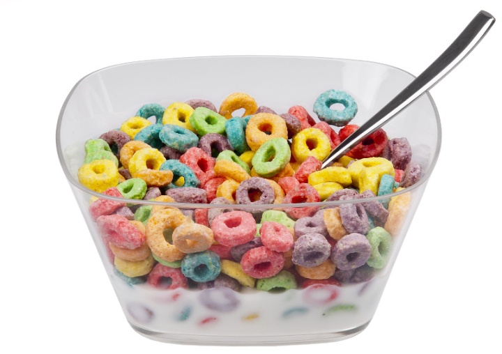 A bowl of Kellogg's Froot Loops cereal. Shown in a clear bowl with a spoon and milk.