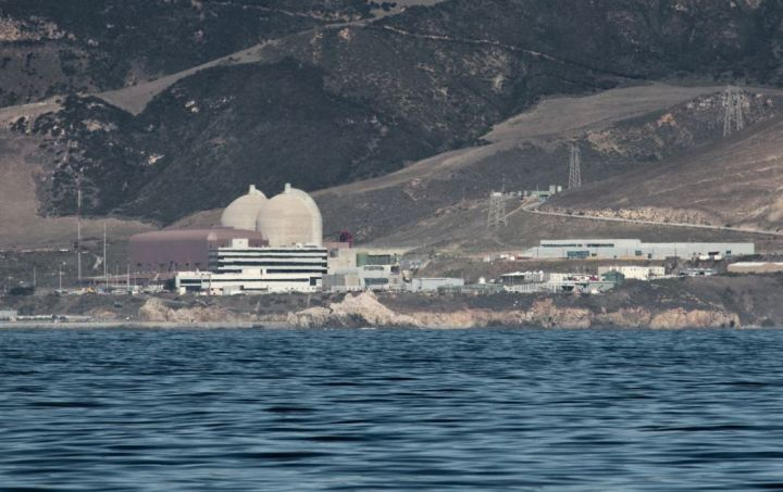 """More details Diablo Canyon Power Plant, 2009 photo from offshore. The light beige domes are the containment structures for Unit 1 and 2 reactors. The brown building is the turbine building where electricity is generated and sent to the grid. In the foreground is the Administration Building (black and white stripes). Picture:  """"Mike"""" Michael L. Baird via Wikimedia"""