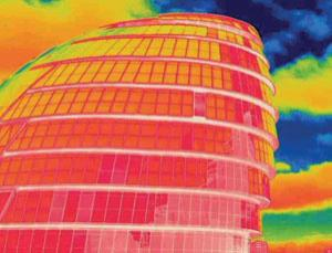 This picture, taken with a thermal imaging camera, reveals how much heat is being emitted by City Hall in London (Image: National Pictures)