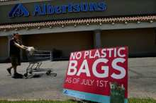 HACIENDA HEIGHTS, CA. - JULY 22, 2011: Roger Blanco heads to his car with his groceries as customers and grocers at Albertson's in Hacienda Heights are adjusting to the plastic bag ban that went into effect on July 1 in unincorporated areas of Los Angeles County. (Anne Cusack /Los Angeles Times)
