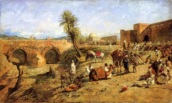 Arrival of a caravan outside a city in Morocco.