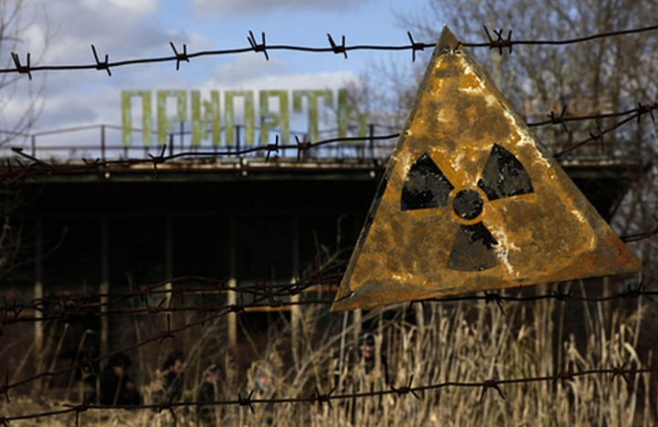 A radioactive sign hangs on barbed wire outside a café in Pripyat.
