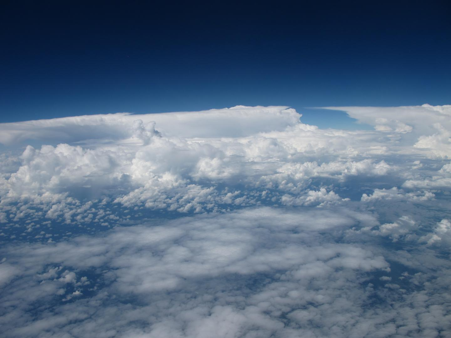 On this picture, thin mid-level clouds are observed in the foreground with deep convective clouds in the background. CREDIT Photograph: Radovan Krejci, co-author of the study