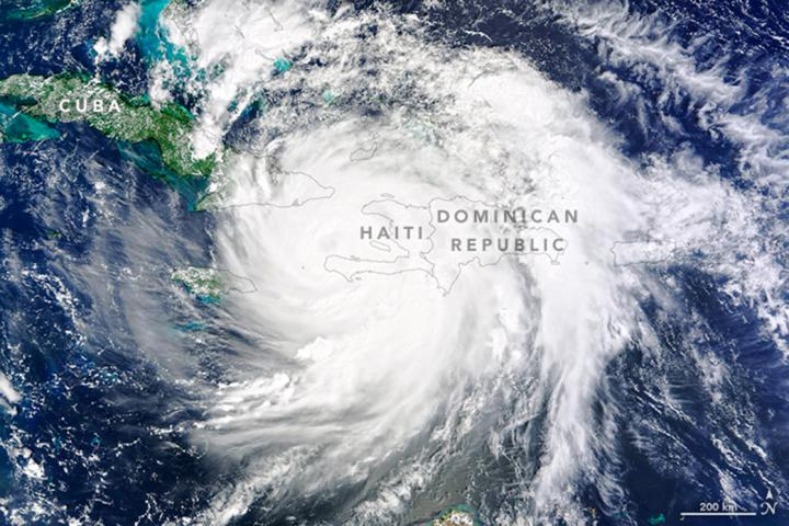 On Oct. 4, 2016, Hurricane Matthew made landfall on southwestern Haiti as a category-4 storm -- the strongest storm to hit the Caribbean nation in more than 50 years. Just hours after landfall, the Moderate Resolution Imaging Spectroradiometer (MODIS) on NASA's Terra satellite acquired this natural-color image. At the time, Matthew had top sustained winds of about 230 kilometers (145 miles) per hour. Credits: NASA Earth Observatory image by Joshua Stevens