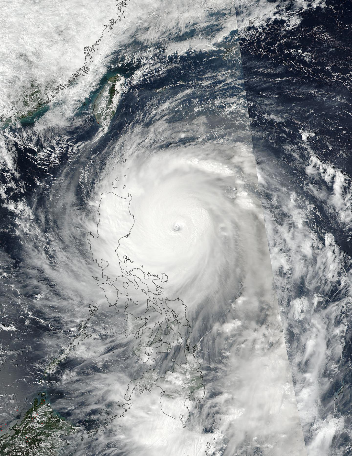 This visible image of Haima was taken on Oct. 19 at 1:35 a.m. EDT (05:35 UTC) from the NASA-NOAA Suomi NPP satellite. The Super Typhoon's cloud-filled eye was clearly visible and surrounded by thick bands of powerful thunderstorms. Credits: NOAA/NASA's MODIS Rapid Response Team
