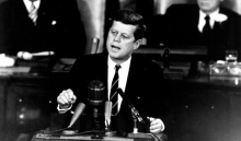 "President John F. Kennedy in his historic message to a joint session of the Congress, on May 25, 1961 declared, ""...I believe this nation should commit itself to achieving the goal, before this decade is out, of landing a man on the Moon and returning him safely to the Earth."""
